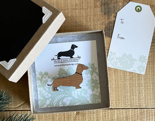 Pickle Dog Design product packaged using Paper Mart natural kraft jewelry boxes, cotton filler, and tag