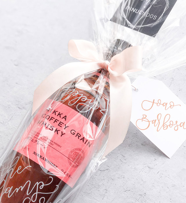 engraved whiskey bottle by Ink & Innuendos wrapped in Paper Mart cellophane wrap and finished with Paper Mart satin ribbon and tag