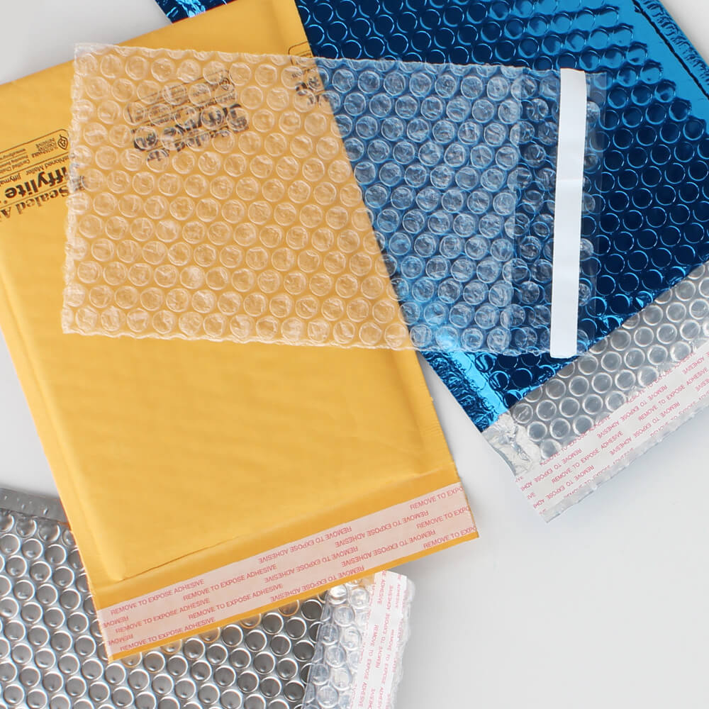 A flat lay photo of Paper Mart Bubble Mailers, Metallic Bubble Mailers, and Self-Sealing Bubble Bags
