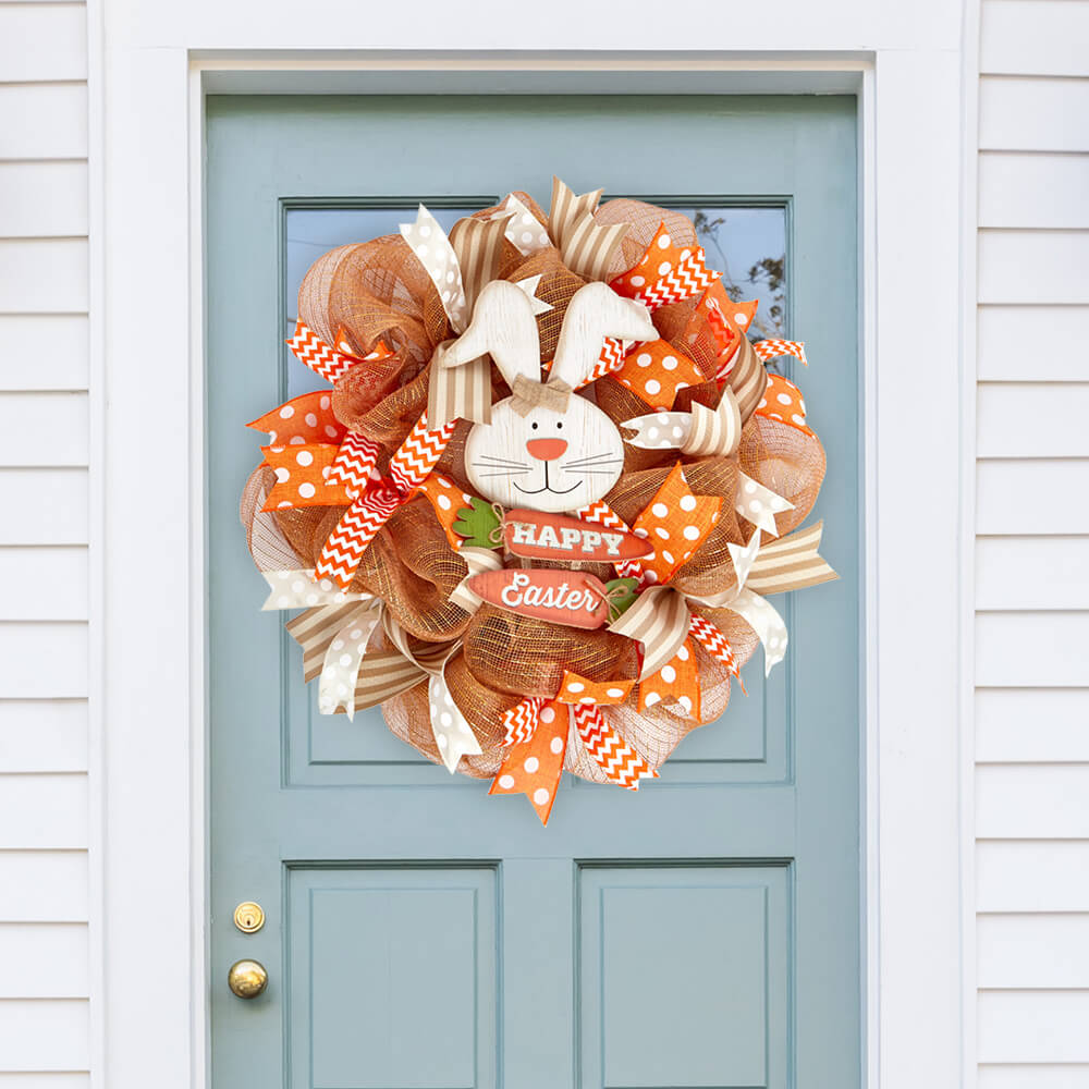 Easter wreath made with Paper Mart ribbons and deco mesh displayed on a door