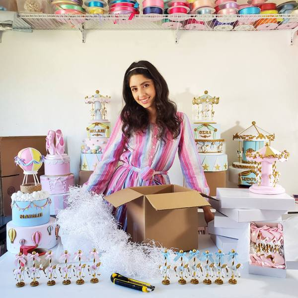 Owner and founder of Smashing Cake Toppers, Analy Garcia with Paper Mart boxes, cushioning, and Paper Mart ribbons