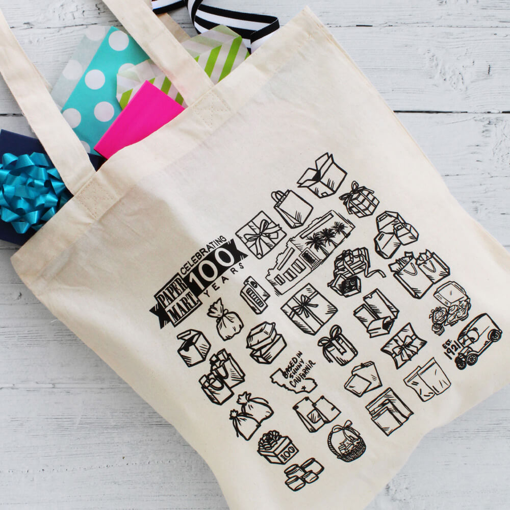 Paper Mart's 100 Year Anniversary Tote with gift boxes, bags, and ribbons inside