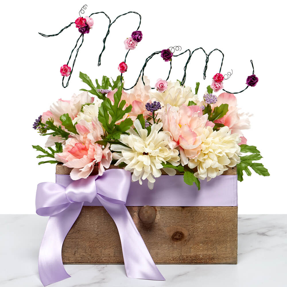 """floral bouquet in a wood container accented by a paper mart satin ribbon and """"mom"""" garden label"""