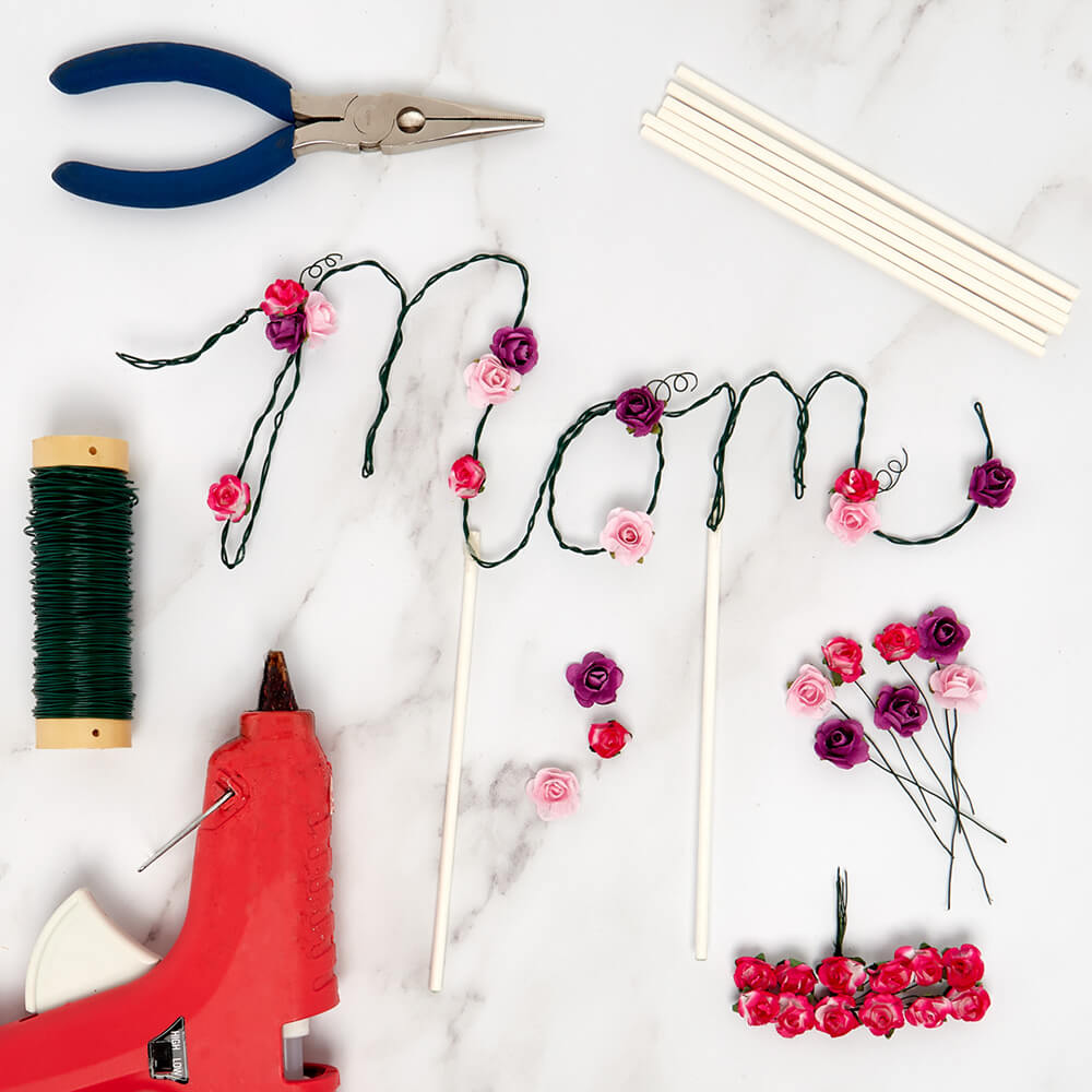 handmade wire label for Mother's Day surrounded by paper mart craft items