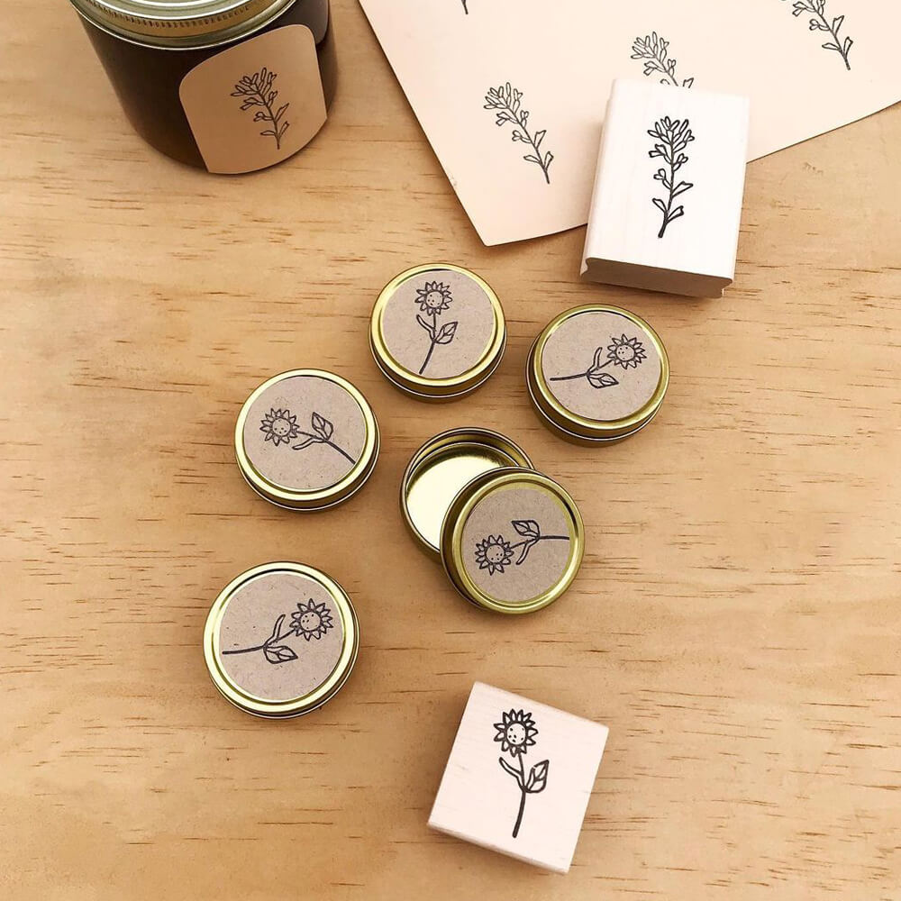 Paper Mart round gold tins customized with handcrafted stamps and labels by Brown Pigeon