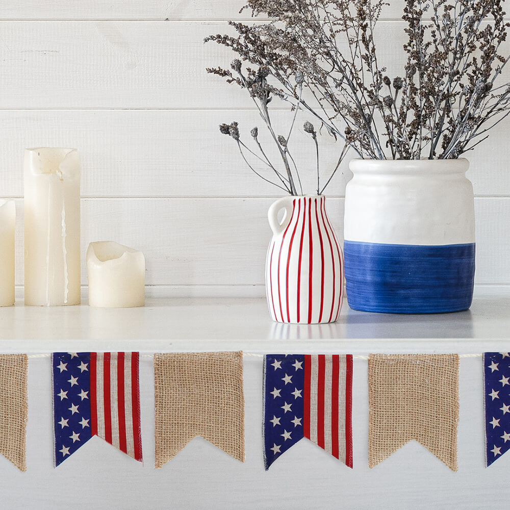DIY Patriotic banner made of Paper Mart ribbons and cord styled on a mantle