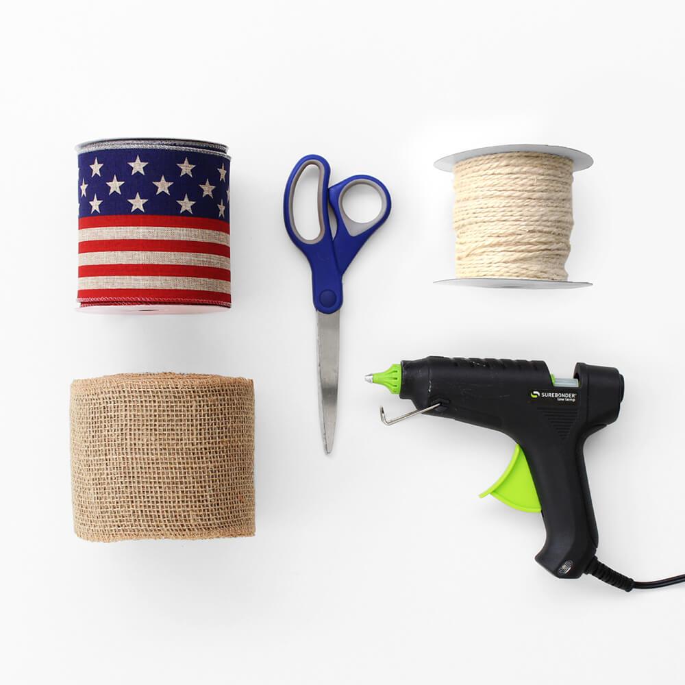 flat lay of Paper Mart craft items like ribbons, cord, and a hot glue gun