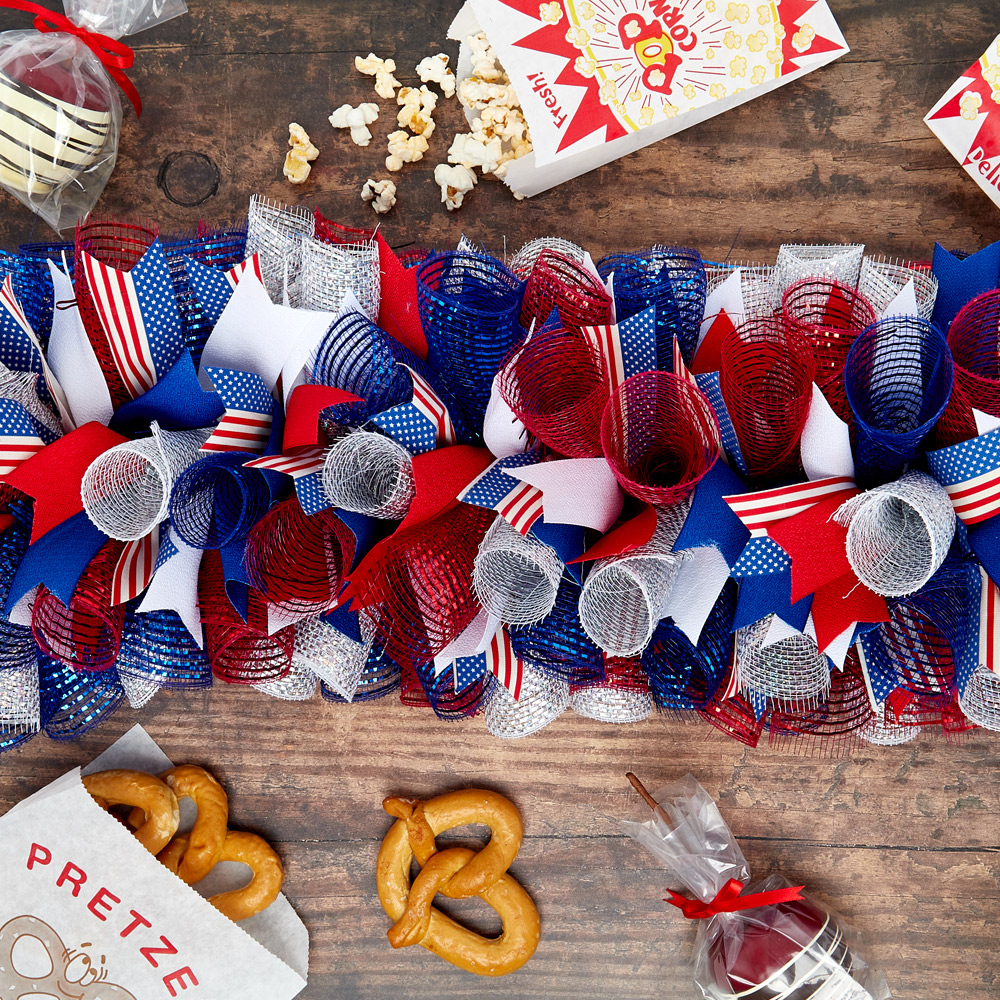 flat lay of a festive 4th of july deco mesh centerpiece