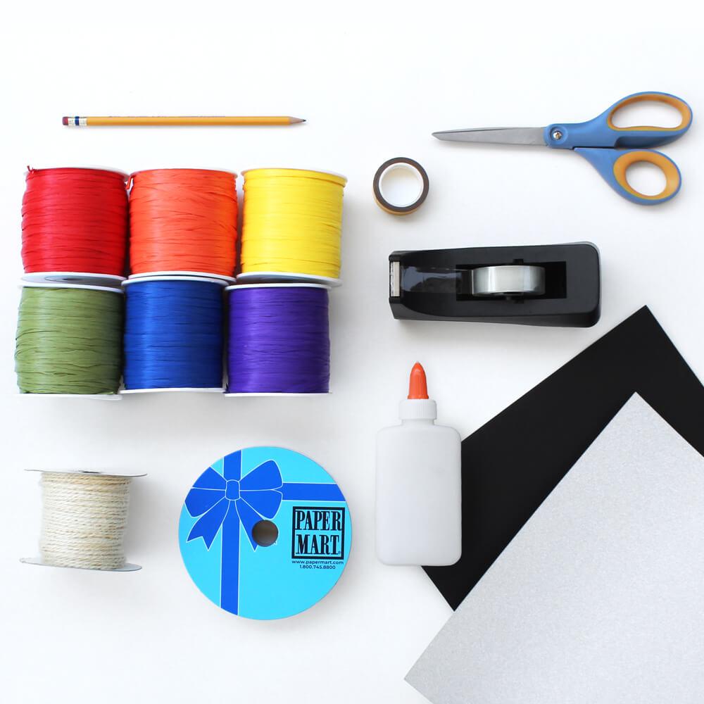 flat lay of paper mart craft supplies to make wall art