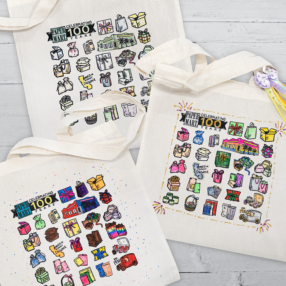 flat lay of 3 decorated paper mart tote bags