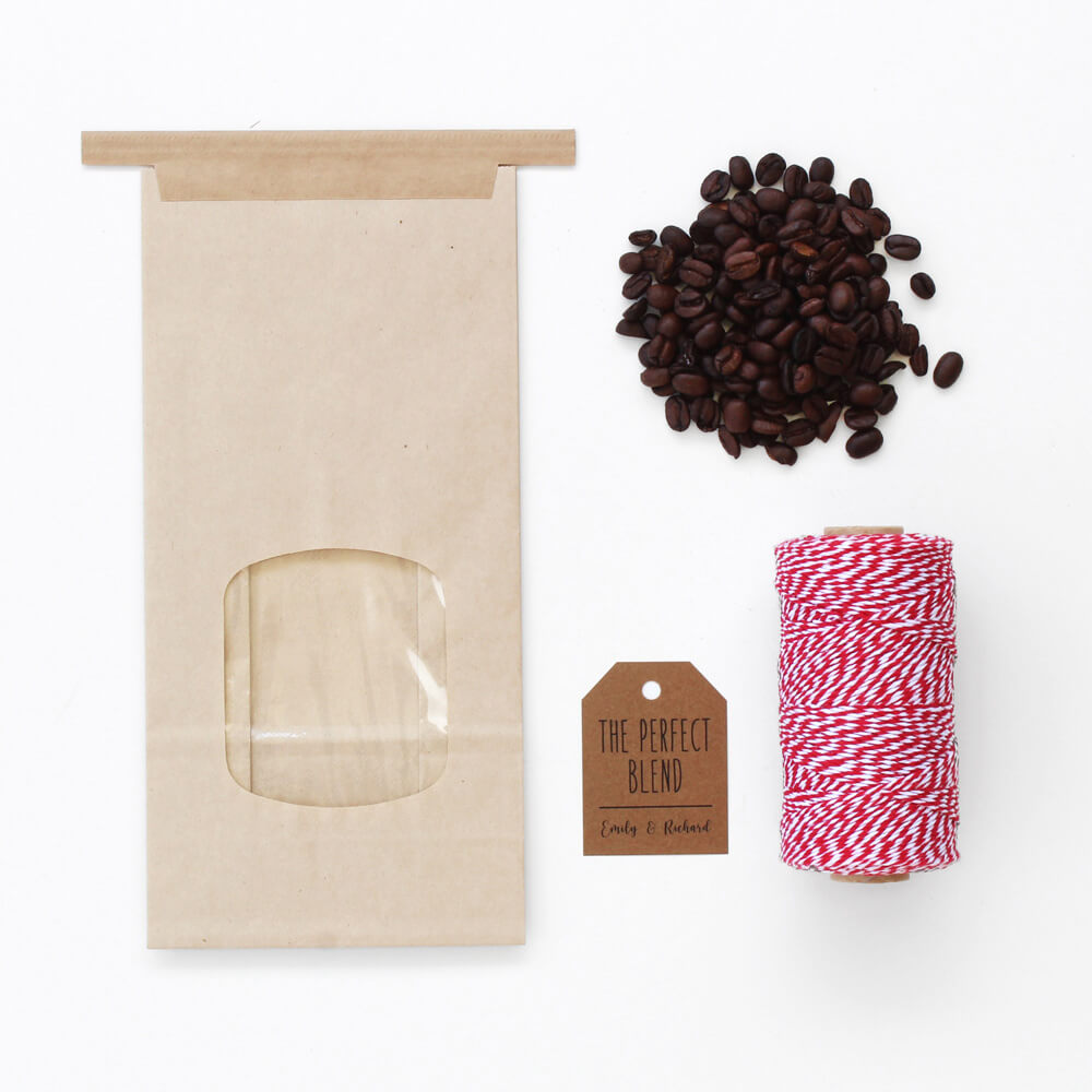 flat lay of coffee packaging tin tie bag, bakers twine, coffee grounds, and label