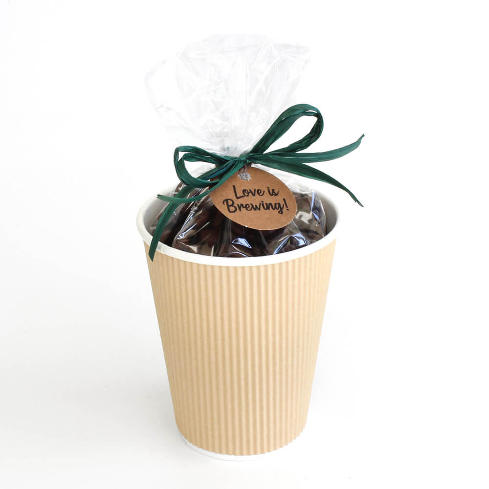 coffee gift in a cup with raffia ribbon and label