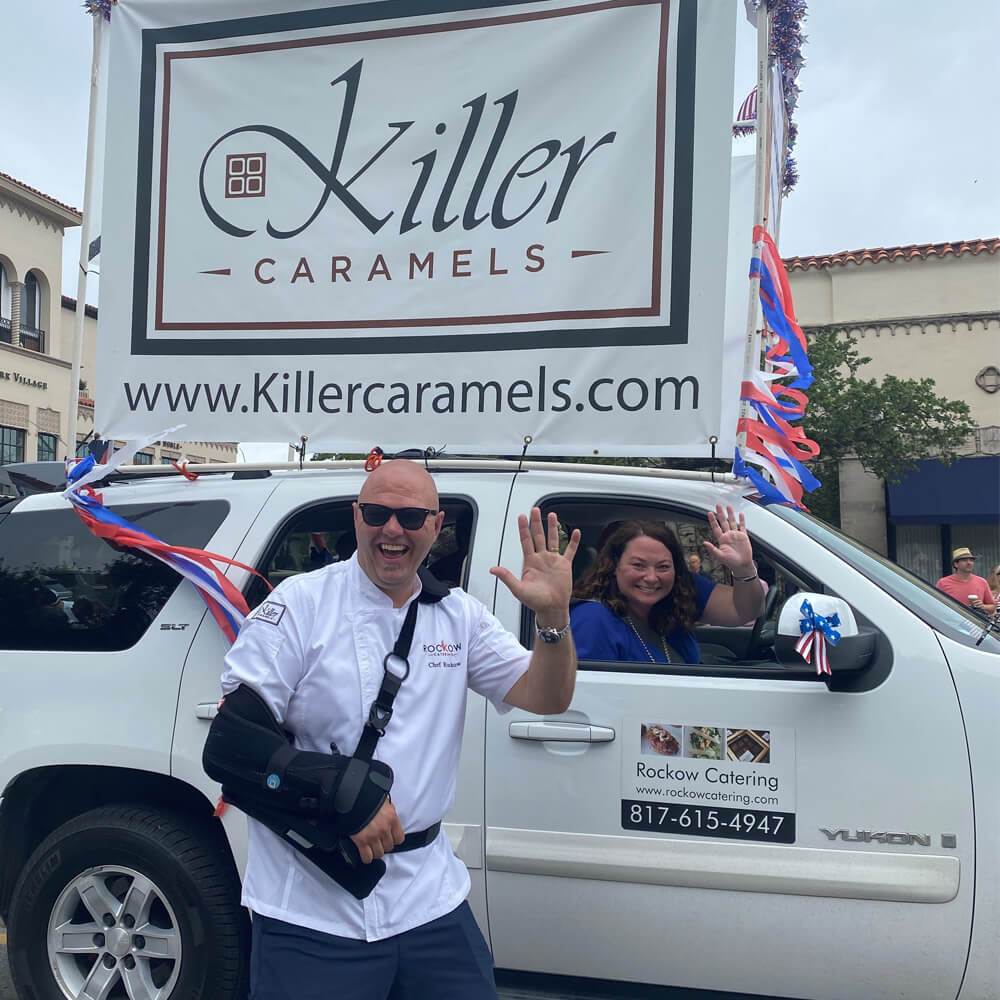 Jeff Rockow of Rockow Catering waving in front of a truck decorated with colorful streamers