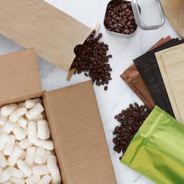 flat lay of paper mart coffee packaging and shipping supplies