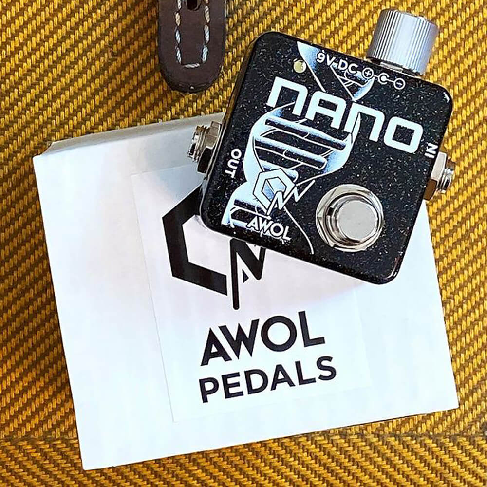 flat lay of AWOL pedals Nano pedal on top a paper mart shipping box